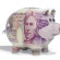 Piggy back covered in twenty pound note isolated on a white background